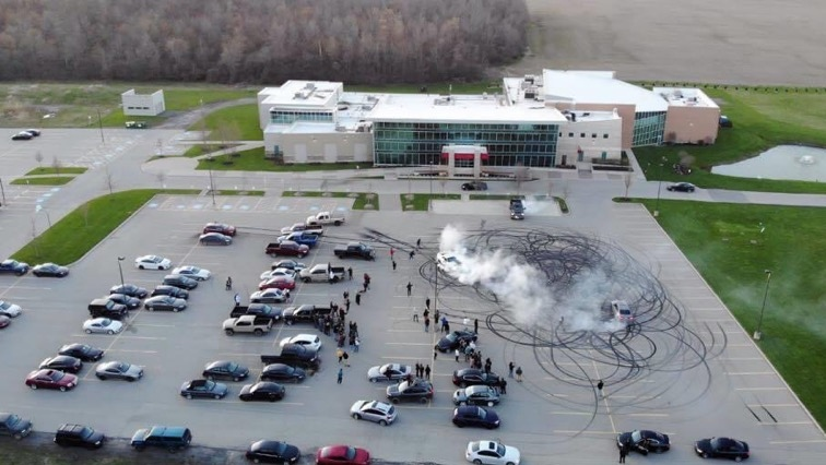 This image taken from video shows cars doing donuts and burnouts in the parking lot of the Forest City Community Church in London, Ont. (Source: Nick Taylor)