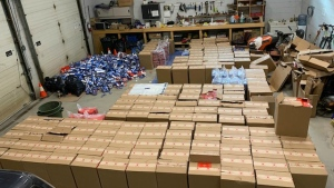 Ontario Provincial Police discovered 160 boxes of illegal cigarettes near Blind River May 10 after the pickup towing a trailer full of smokes ended up in the ditch. (Supplied)