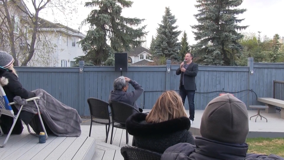 Lars Callieou performing a backyard comedy show
