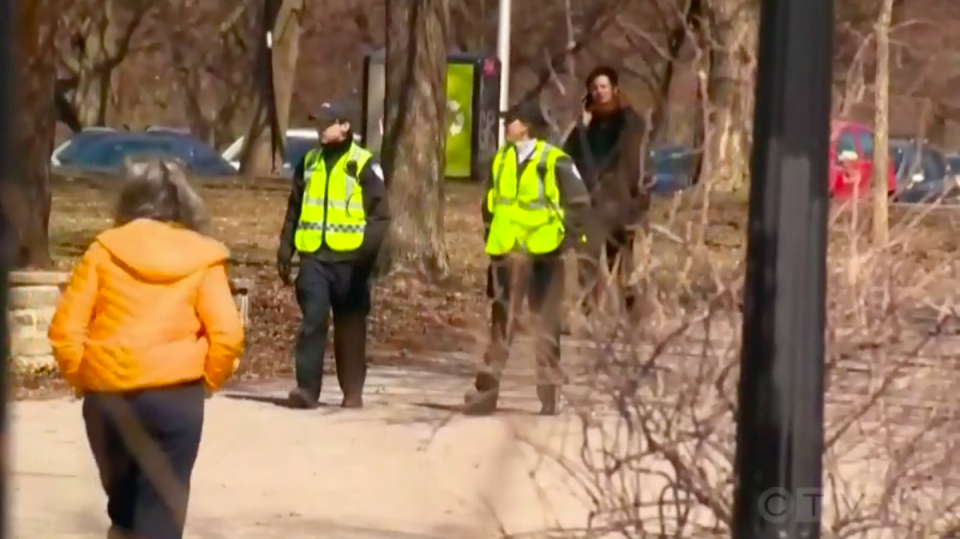 Police patrol a public park to see if social distancing rules are being respected.