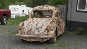 Island driftwood artist creates full car sculpture