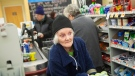 Roberta Miller, 74, loads her items at the checkout at a Stop & Shop supermarket during hours open daily only for seniors Thursday, March 19, 2020, in North Providence, R.I. (AP / David Goldman)