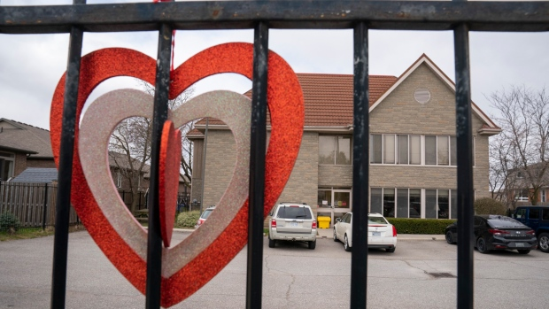 A heart hangs on the fence at Anson Place care centre in Hagersville, Ontario on Wednesday, April 22, 2020. THE CANADIAN PRESS/Frank Gunn