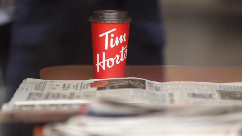 A Tim Hortons cup is seen inside a Tim Hortons restaurant in Toronto, Friday, March 6, 2020. (THE CANADIAN PRESS / Cole Burston)