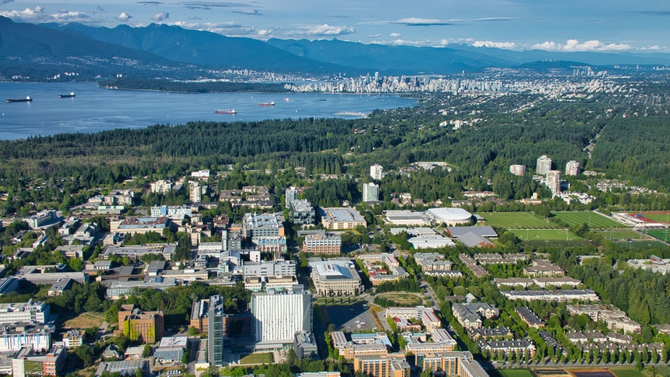 The University of British Columbia campus is seen in the foreground, with downtown Vancouver in the background, in this photo from June 2019.
