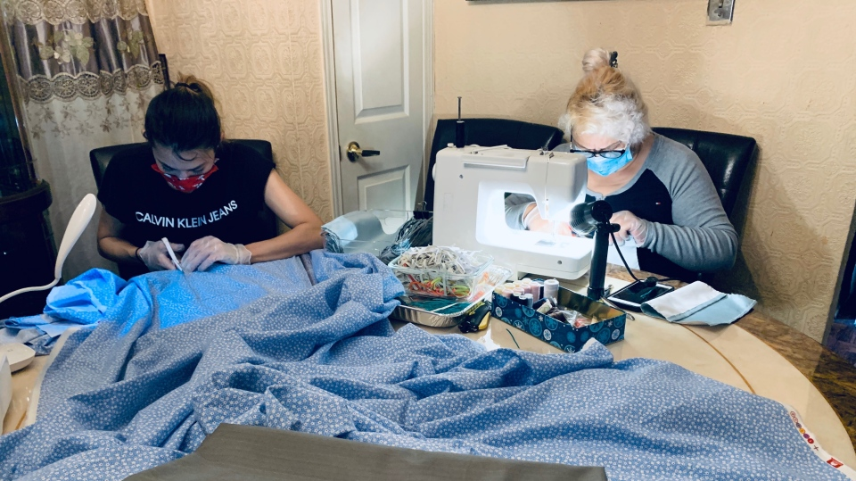 Celina Urbanowicz and her two daughters have been helping to make cloth masks for residents during the COVID-19 pandemic.