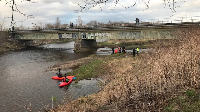 Members of the Truro Fire Service and the Colchester Ground Search and Rescue team deploy a mannequin in Leppers Brook in Truro, N.S. on Wednesday evening. (CTV ATLANTIC / JIM KVAMMEN)