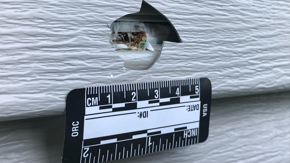A bullet hole in the siding of a Beaumont home. May 13, 2020. (Sean Amato/CTV News Edmonton)
