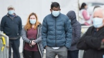 People wait in line at a COVID-19 walk-in test clinic in Montreal North, Sunday, May 10, 2020, as the COVID-19 pandemic continues in Canada and around the world. THE CANADIAN PRESS/Graham Hughes