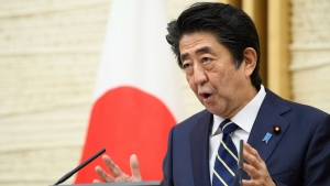 Japanese Prime Minister Shinzo Abe gestures while speaking during a press conference at his official residence in Tokyo Thursday, May 14, 2020. (Akio Kon/Pool Photo via AP)