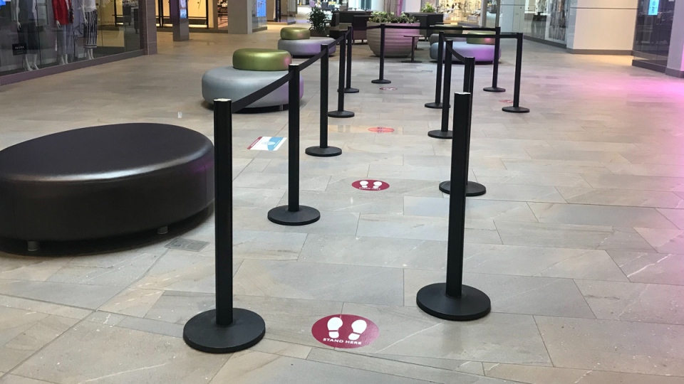 The Premier Collection Outlet at the Edmonton International Airport is using decals to remind customers to keep a physical distance while they shop as malls reopen during the COVID-19 pandemic. May 14, 2020. (CTV News Edmonton)