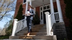 Prime Minister Justin Trudeau walks to the podium for a daily briefing outside Rideau Cottage in Ottawa, Thursday, May 14, 2020. THE CANADIAN PRESS/Adrian Wyld