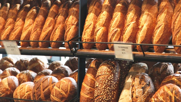 Loaves of sourdough bread are shown for sale at the flagship Boudin bakery at Fisherman's Wharf in San Francisco, Wednesday, Feb. 4, 2009. (AP / Eric Risberg)