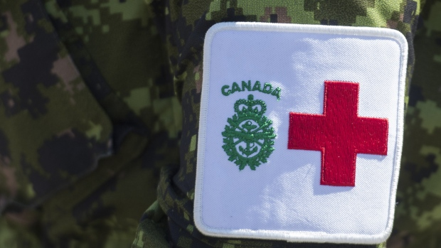 A patch is seen on a member of the Canadian Armed Forces at Residence Yvon-Brunet a long-term care home in Montreal, Saturday, April 18, 2020. The Canadian Forces say five members working in long-term care homes amid the COVID-19 pandemic have tested positive for the illness. THE CANADIAN PRESS/Graham Hughes