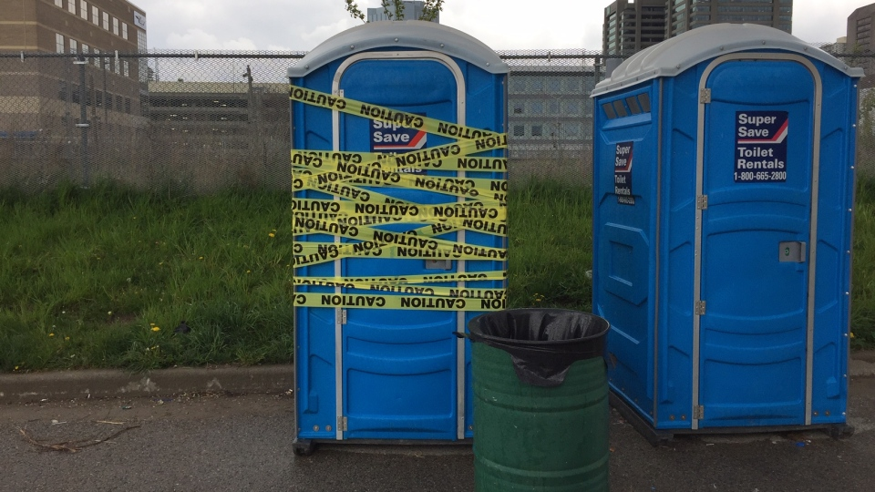 A portable toilet near a tent city that was the scene of an overdose is seen in London, Ont., Friday, May 15, 2020. (Bryan BIcknell / CTV London)