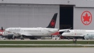 Air Canada planes are shown on the tarmac at Montreal-Pierre Elliott Trudeau International Airport, Saturday, May 16, 2020. THE CANADIAN PRESS/Graham Hughes