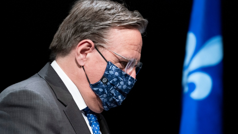Quebec Premier Francois Legault, wearing a protective mask, walks away following a news conference in Montreal, on Friday, May 15, 2020. THE CANADIAN PRESS/Paul Chiasson
