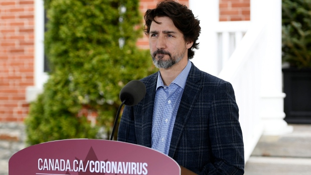 Prime Minister Justin Trudeau speaks during his daily news conference on the COVID-19 pandemic outside his residence at Rideau Cottage in Ottawa, on Saturday, May 16, 2020. THE CANADIAN PRESS/Justin Tang