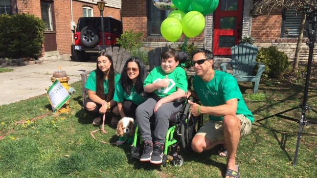 Community raises spirits of teen cancer survivor with 12-minute parade