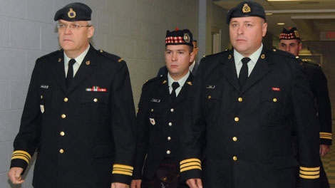 Cpl. Matthew Wilcox, centre, is escorted from the courtroom by Capt. Donald MacGillivary, left and defence counsel Lt. Col. Troy Sweet, right. at the Victoria Park Garrison in Sydney N.S. Tuesday, Sept.29, 2009. (THE CANADIAN PRESSVaughan Merchant)