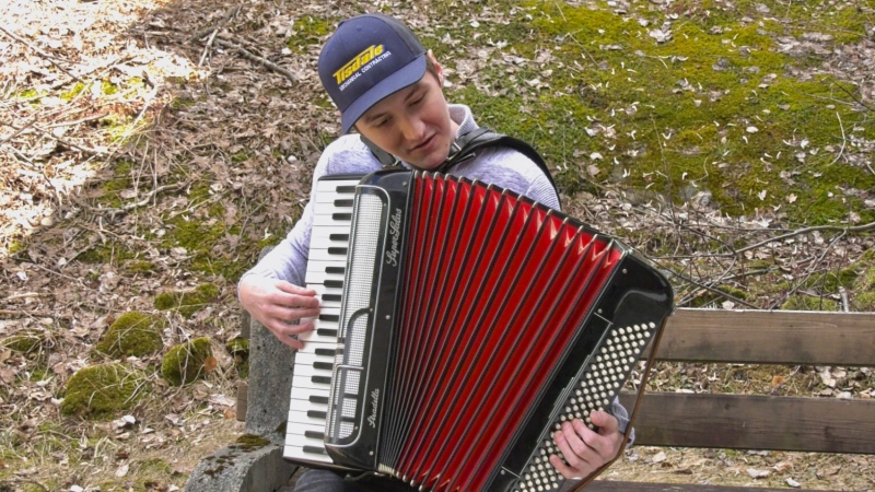 Timmins musician Paul Sebalj doesn't hesitate to play a jig on his accordion to set a fun mood for his interview. May 16/2020 (Lydia Chubak/CTV News Northern Ontario)