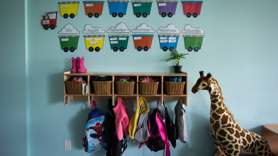 Children's backpacks and shoes are seen at a daycare on Tuesday May 29, 2018. THE CANADIAN PRESS/Darryl Dyck
