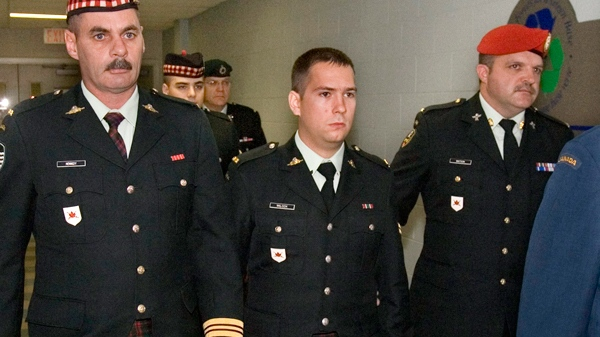 Cpl. Matthew Wilcox is escorted from the courtroon during a break in proceedings in Sydney, N.S., on Tuesday, Sept. 30, 2009. (Andrew Vaughan / THE CANADIAN PRESS)