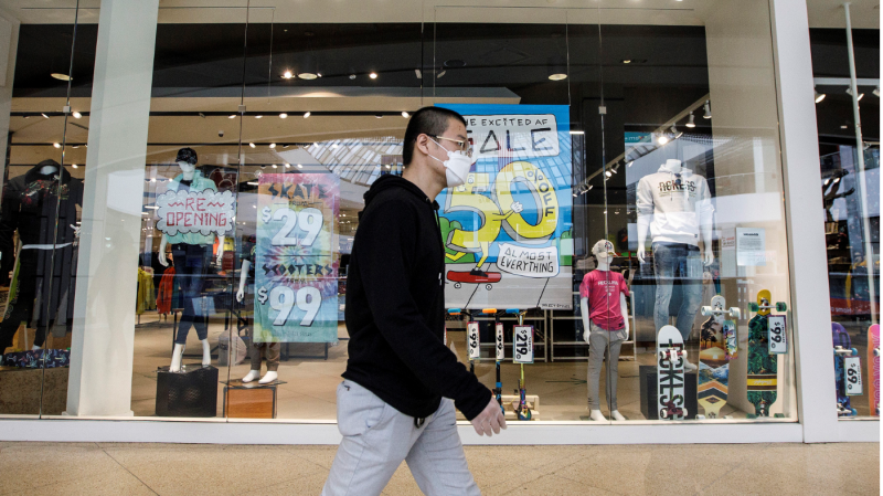 A shopper walks past a store in the West Edmonton Mall on the first day of the mall's reopening during the COVID-19 pandemic, in Edmonton on Thursday, May 14, 2020. THE CANADIAN PRESS/Jason Franson