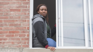 Carole Ze Benedicte, who is originally from Cameroon, poses at her apartment in Montreal, Saturday, May 16, 2020. THE CANADIAN PRESS/Graham Hughes