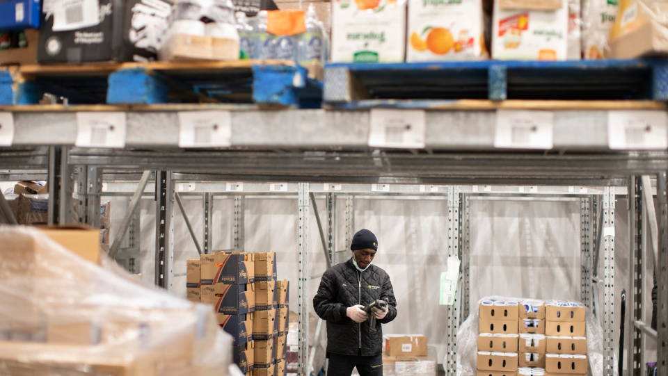 A staff member at the Daily Bread Food Bank stands in their cold storage unit at their warehouse in Toronto on Wednesday March 18, 2020. THE CANADIAN PRESS/Chris Young