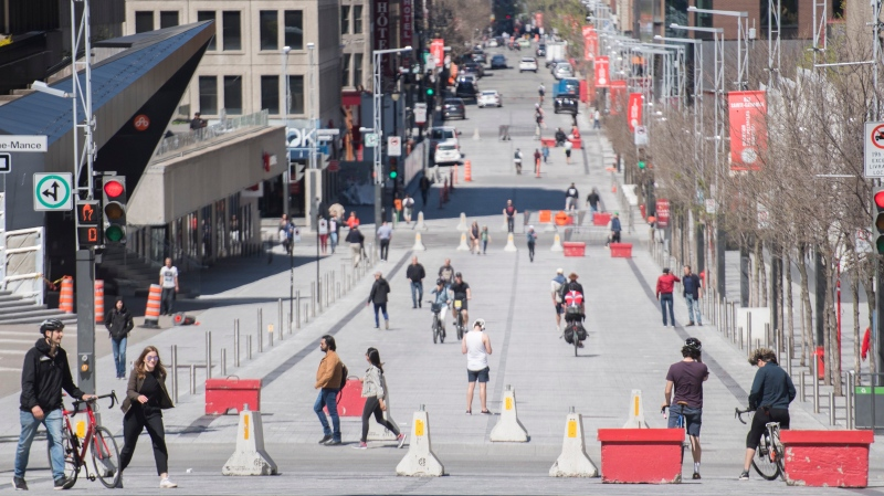 People walk along a pedestrianized zone of Sainte-Catherine street in Montreal, Monday, May 18, 2020, as the COVID-19 pandemic continues in Canada and around the world. THE CANADIAN PRESS/Graham Hughes