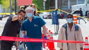 People line up at a mobile COVID-19 testing clinic, Tuesday, May 19, 2020 in Montreal.THE CANADIAN PRESS/Ryan Remiorz