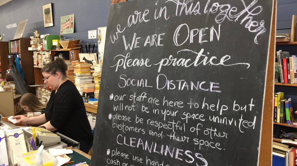 Physical distancing sign at Attic Books
