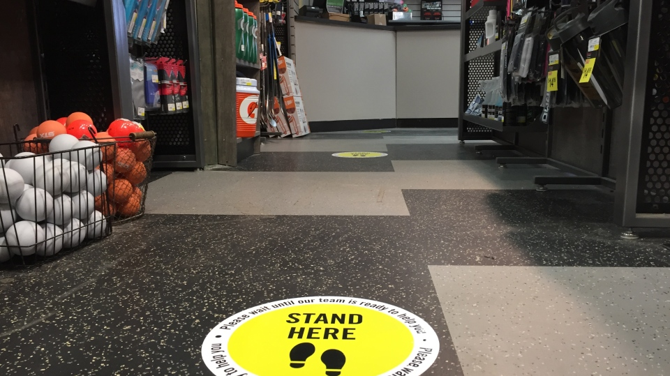 Physical distancing floor stickers