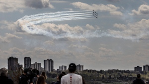 The snowbirds fly over Edmonton as part of Operation Inspiration, their cross-country salute to Canadians helping fight the spread of COVID-19 on Friday, May 15, 2020. THE CANADIAN PRESS/Jason Franson