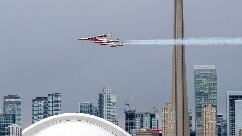 The Canadian Forces Snowbirds fly past the Toronto skyline as part of Operation Inspiration, their cross-country salute to Canadians helping fight the spread of COVID-19, on Sunday, May 10, 2020. THE CANADIAN PRESS/Frank Gunn