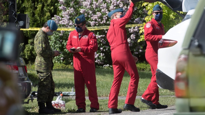 Members of the Royal Canadian Air Force Snowbird team are seen at the crash site in Kamloops, B.C., Monday, May 18, 2020. THE CANADIAN PRESS/Jonathan Hayward