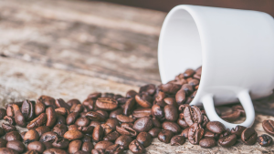 Coffee Beans and White Mug (Jessica Lewis/Pexels)
