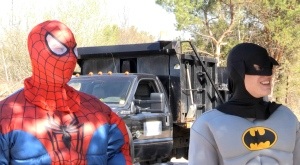 The dynamic duo of Joshua Loxton and Greg James were clad in their superhero masks Wednesday in Powassan, all while picking up garbage around town. (Eric Taschner/CTV Northern Ontario)