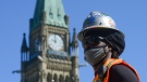 Construction worker Rory Brissett works on Parliament Hill during the COVID-19 pandemic in Ottawa on Wednesday, May 20, 2020. (Sean Kilpatrick/THE CANADIAN PRESS)