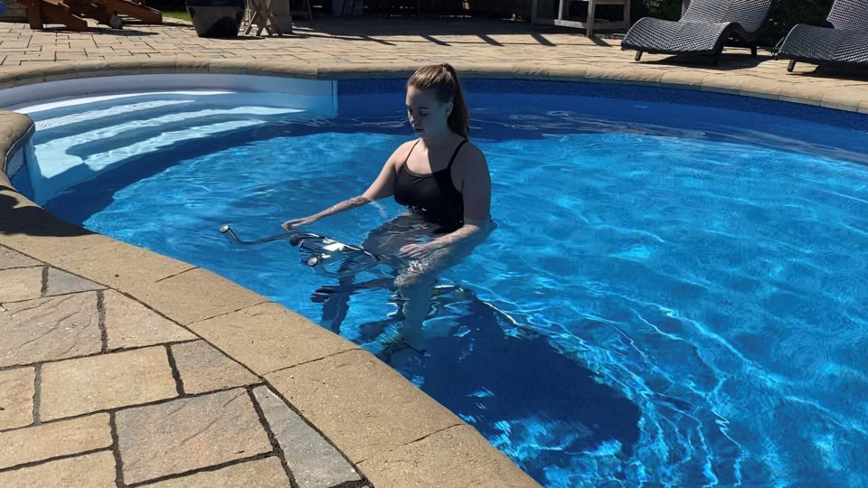 Synchronized swimmer Michela Mantler is exercising in her pool at home with LiquidGym equipment rental. Ottawa, ON. May 20, 2020. (Tyler Fleming / CTV News Ottawa)