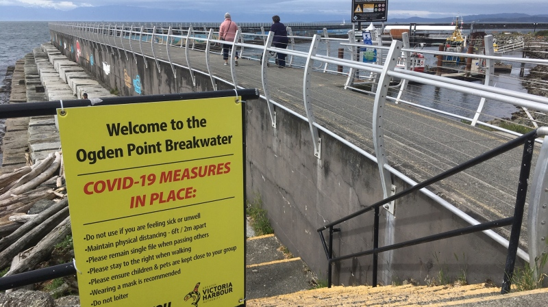 Victoria's Ogden Point Breakwater officially reopened to the public Wednesday at 10 a.m., with signage posted outlining rules for safe use of the facility during the COVID-19 pandemic. (CTV)