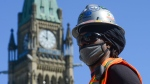 Construction worker Rory Brissett works on Parliament Hill during the COVID-19 pandemic in Ottawa on Wednesday, May 20, 2020. THE CANADIAN PRESS/Sean Kilpatrick