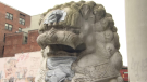 Graffiti on the lion statues in Vancouver's Chinatown neighbourhood is covered up on Wednesday, May 20, 2020.