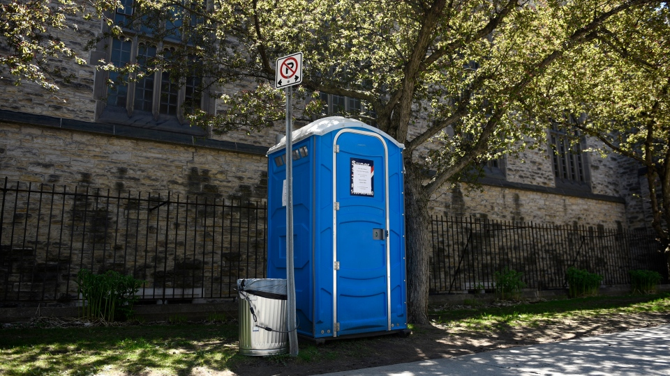 A porta-pottie beside Knox Presbyterian Church in downtown Ottawa, placed to allow people including those who are homeless or precariously housed to access a washroom, is seen on Wednesday, May 20, 2020 during the COVID-19 pandemic. (THE CANADIAN PRESS/Justin Tang)