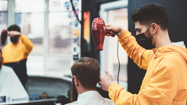 Shaggy locks and showing roots have had many Canadians dreaming of returning to the barber or salon chair. But the new reality of masks, plastic dividers, physically distancing and hyper-cleaning makes the experience very different than pre-pandemic times.