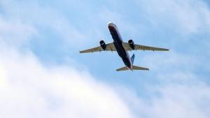 A Russian Air Force Tu-214 flies over Offutt Air Force Base, on April 26, 2019, in Omaha, Neb. (Chris Machian/Omaha World-Herald via AP)