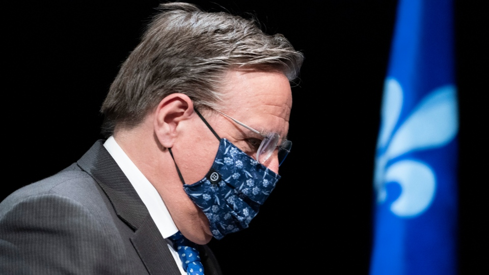 Quebec Premier Francois Legault, wearing a protective mask, at a news conference in Montreal. THE CANADIAN PRESS/Paul Chiasson