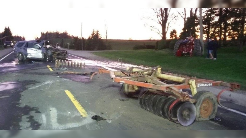 A damaged SUV is seen after it collided with a tractor towing farm equipment in Georgian Bluffs, Ont. on Wednesday, May 20, 2020. (Source: Grey Bruce OPP)