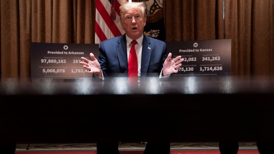 U.S. President Donald Trump speaks during a meeting with Arkansas Gov. Asa Hutchinson, and Kansas Gov. Laura Kelly, in the Cabinet Room of the White House, Wednesday, May 20, 2020, in Washington. (AP Photo/Evan Vucci)
